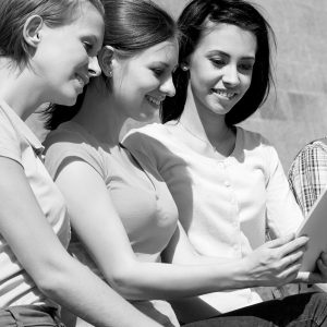 Young women looking at a book